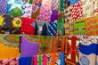Leinwanddruck Bild Plenty of colorful African fabrics in a rows