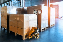 Stack Cardboard Boxes Wrapping Plastic On Pallets And Hand Pallet Truck, Package Boxes, Loading Freight Truck , Warehouse Industrial Service Logistics, Shipment Goods Transport