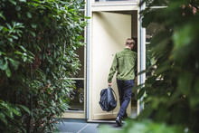 Male Entrepreneur With Bag Ent...