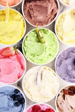 Various Of Ice Cream Flavor Whit Fresh Blueberry, Strawberry, Kiwi, Lemon, Vanilla Setup On Rustic Background . Summer And Sweet Cold Ice Cream