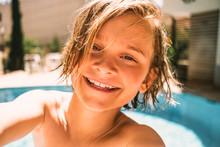 Portrait Of Smiling Boy By Swi...