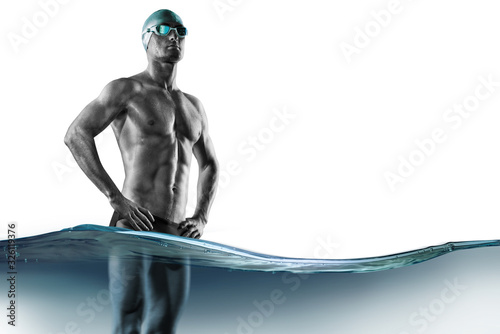 Swimming pool. Isolated muscular swimmer ready to start. Fototapeta