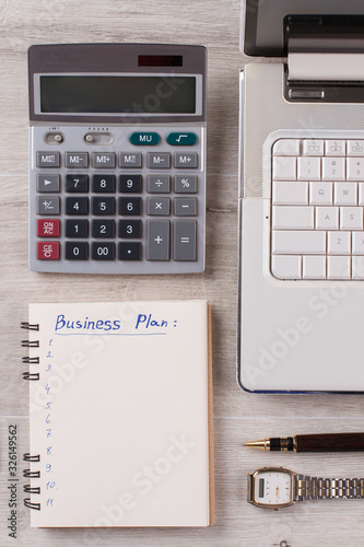 Laptop, calculator and stationery. Office flatlay on wooden background close up. - 326149562