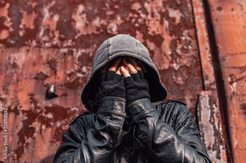 Photo Homeless drug addict having abstinence crisis