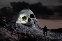 Miniature Scene Of Explorers Approaching Giant Skull In The Landscape