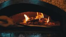 Cooking Pizza In An Italian Wo...