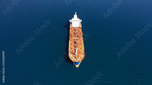 Photo Aerial drone photo of huge fuel tanker ship docked in industrial area of Elefsin