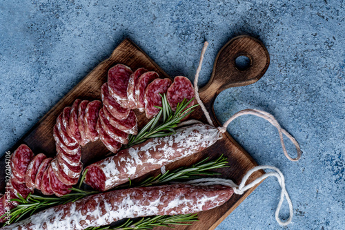 Photo Fuet, a traditional Spanish sausage with rosemary