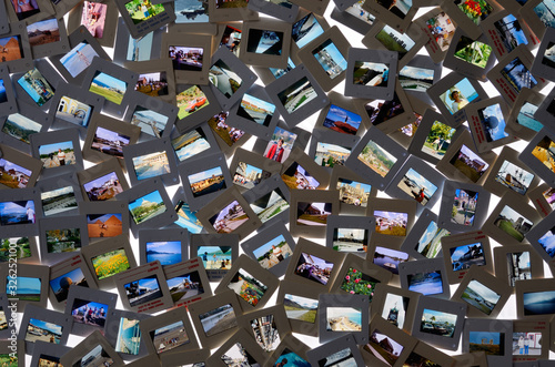 Fotomural Top view of collection of film slide snapshot pictures on a light table