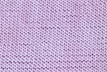 Violet Or Purple Knitted Textured Background. Closeup