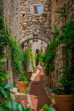 Fototapeta Na drzwi - Old buildings on narrow streets in the medieval city of Eze Village in the South of France along the Mediterranean Sea
