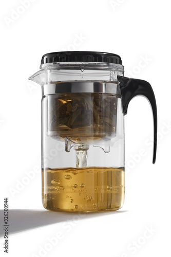 Obraz na plátně Subject shot of a glass teapot with a removable infuser and inlying strainer, a black handle and cover