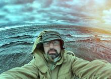 Man-fisherman On  Big Ocean Wave