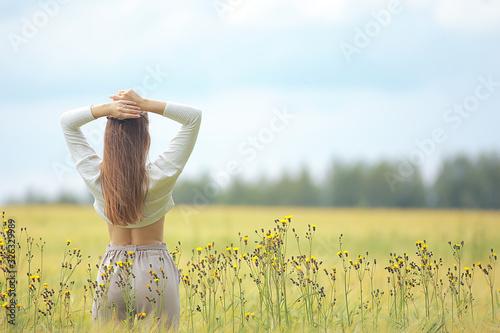 Obraz autumn field girl health / beautiful young model, landscape in a summer field, cute happy model - fototapety do salonu