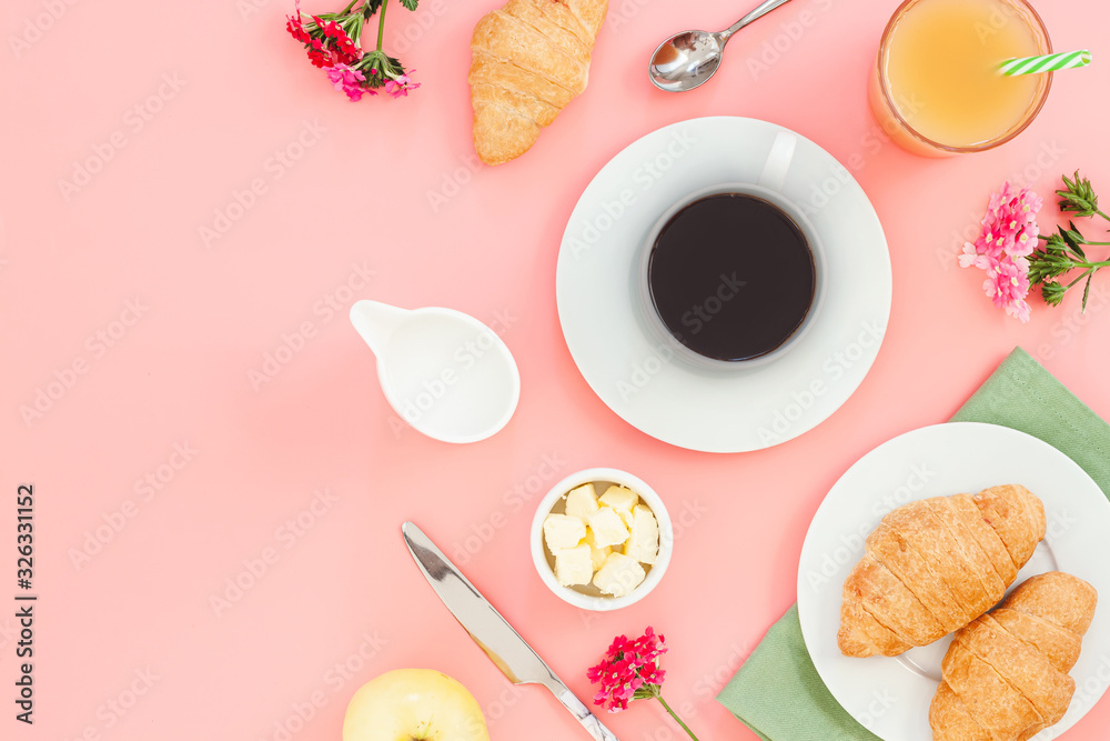 Fototapeta Morning breakfast coffee and croissant, butter, orange juice and flowers on white background. Flat lay, top view