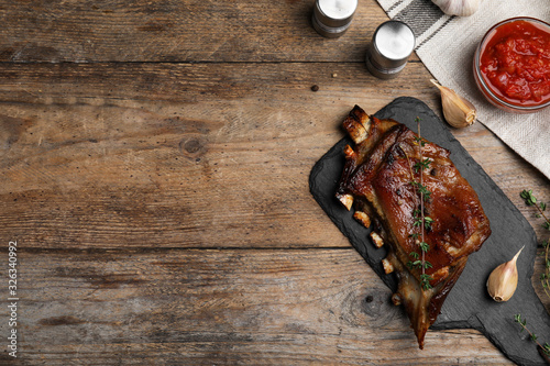 Delicious roasted ribs served on wooden table, flat lay Canvas Print