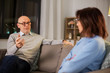 relationships difficulties, communication and people concept - unhappy senior couple arguing or discussing problem at home
