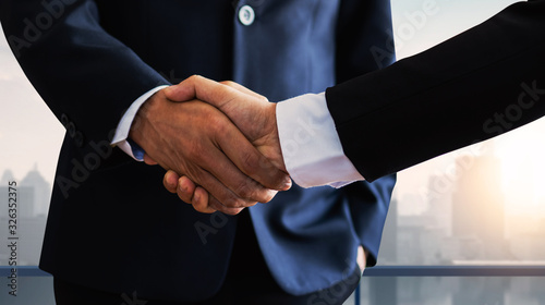 successful negotiate and handshake concept, two businessman shake hand with partner to celebration partnership and teamwork, business deal Wallpaper Mural
