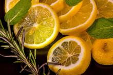 Lemon And Lime Slices On A Bla...