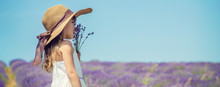 A Child In A Flowering Field O...