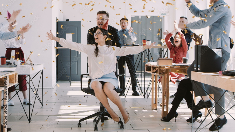 Fototapeta RED EPIC-W Happy fun young brunette business woman celebrating birthday at party with office colleagues slow motion.