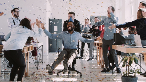 Valokuva RED EPIC-W Happy young black businessman celebrating birthday at office workplace party with confetti slow motion