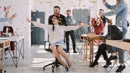 RED EPIC-W Happy fun young brunette business woman celebrating birthday at party with office colleagues slow motion Canvas Print