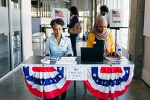 Volunteers Working At Polling ...