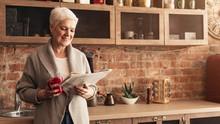 Happy Senior Woman Reading New...