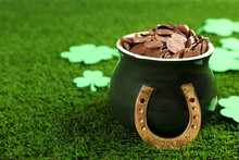 Pot Of Gold Coins, Horseshoe And Clover Leaves On Green Grass, Space For Text. St. Patrick's Day Celebration