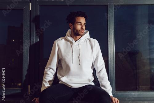Obraz Attractive african american man in hoodie sweater. Mock-up. - fototapety do salonu