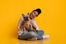 Young Beautiful Afro Woman Posing With Ger Cute Dog In Studio