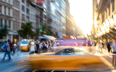 New York City blurred abstract street scene with people and taxis in Midtown Manhattan
