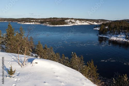 Ladoga Lake  skerries  in winter sunny day Tablou Canvas