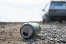 Empty Metal Can On The Side Of The Road. Environmental Pollution Concept.