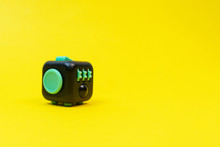 Black And Green Fidget Cube On...