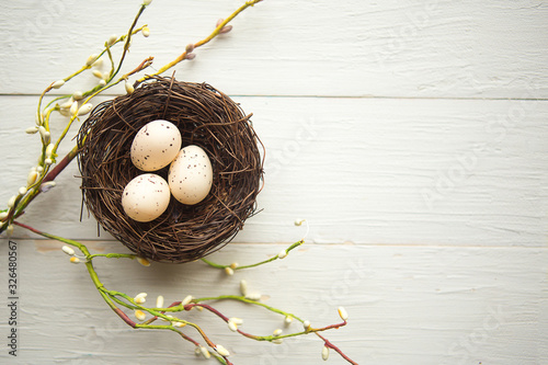 Fototapeta quail eggs in the nest, top view, wooden background, Easter concept