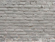 Painted brick wall of an architectural structure in light gray color. Fashionable texture for design.