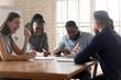 Employees take break during meeting having fun telling jokes laughing