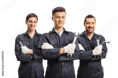 Fototapeta Group of male workers in uniforms with tools obraz