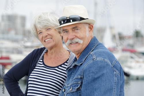 Fototapeta senir couple in a port during holidays time obraz na płótnie