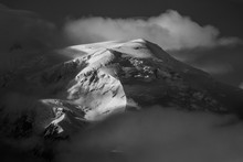 Dome Du Gouter Rising Out Of The Clouds, Mont Blan