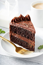 Dark Chocolate Cake Slice With Chocolate Buttercream Frosting
