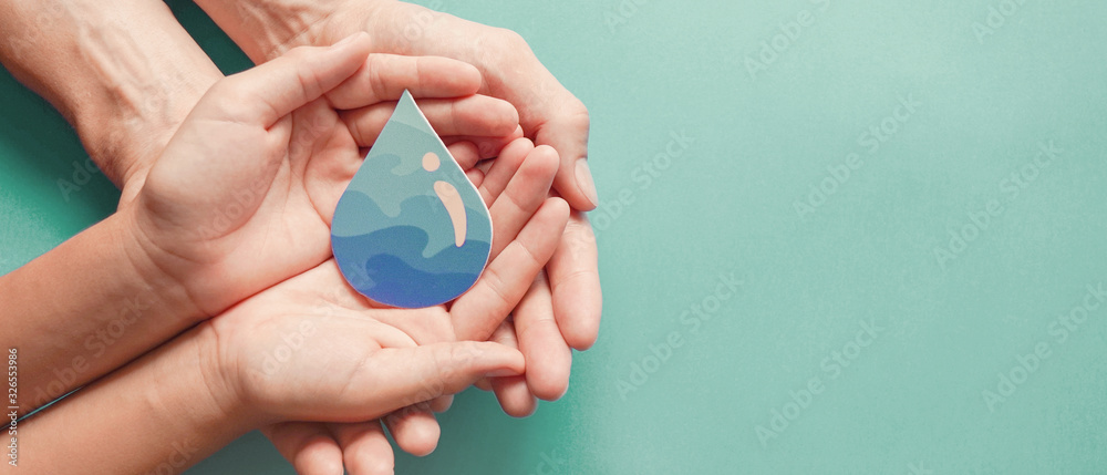 Fototapeta Adult and child hands holding water drop, World Water Day,  Clean water and sanitation, hand sanitizer and hygiene for  coronavirus pandemic, family washing hands, CSR, save water,  ecology concept