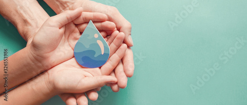 Fototapeta Adult and child hands holding water drop, World Water Day,  Clean water and sanitation, hand sanitizer  and hygiene for covid-19 , family washing hands, CSR, save water,  world ocean day concept  obraz