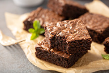 Freshly Baked Homemade Brownies On A Parchment Paper