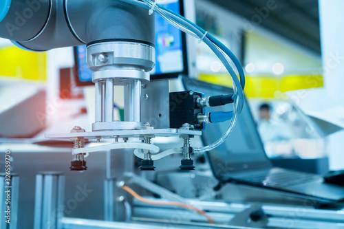 Photo robotic pneumatic piston sucker unit on industrial machine,automation compressed