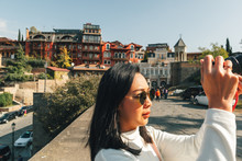 Tourist Woman Is Taking A Phot...