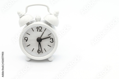 A white retro alarm clock isolated on white background Wallpaper Mural