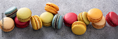 Variety of colorful macarons on the table, french dessert Fototapet